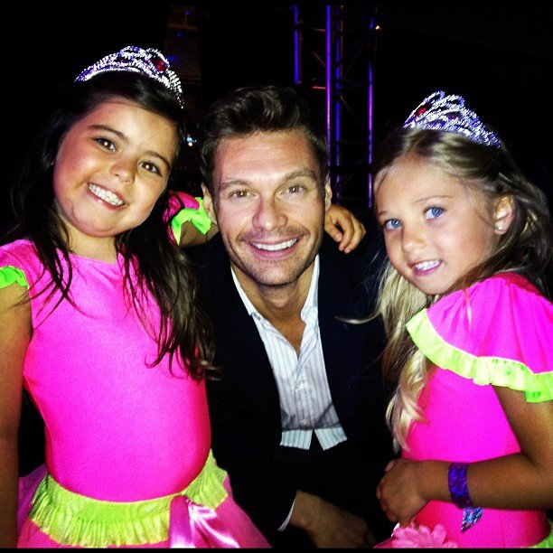 Ryan Seacrest posed with pint-sized Internet stars Sophia Grace and Rosie. Source: Instagram user ryanseacrest