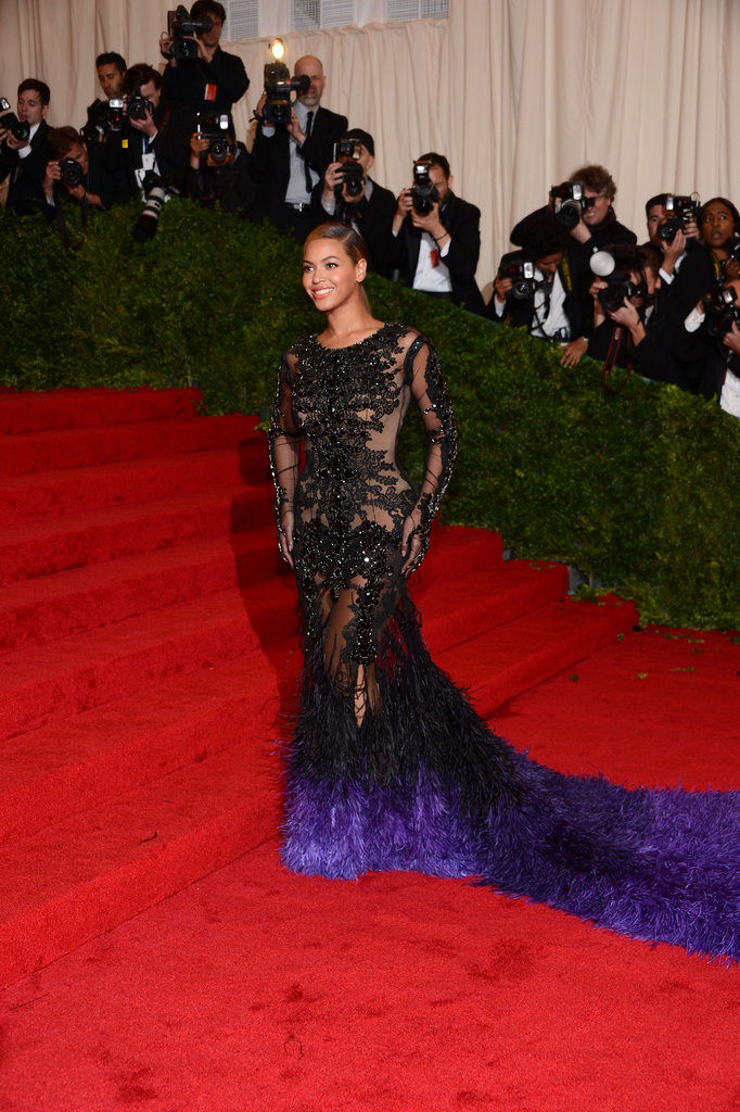Beyoncé Knowles stopped to pose on the stairs at the Met Gala in a stunning see-through design by Givenchy.