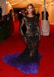 Beyoncé Knowles's gown pooled into a puddle of indigo feathers.