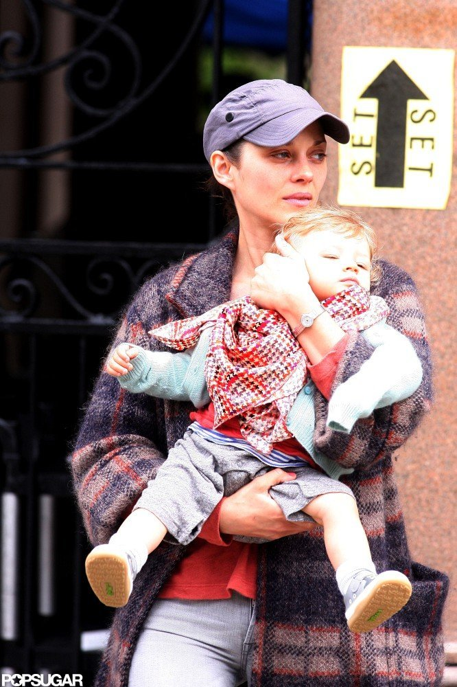 Marion Cotillard's son Marcel made a visit to her set in NYC.