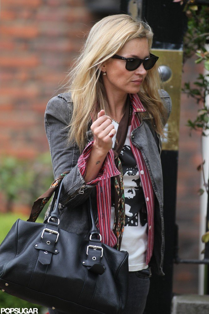 Kate Moss took a stroll in London wearing sunglasses and a denim jacket.