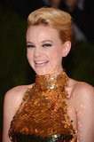Carey Mulligan smiled at the Met Gala wearing Prada.