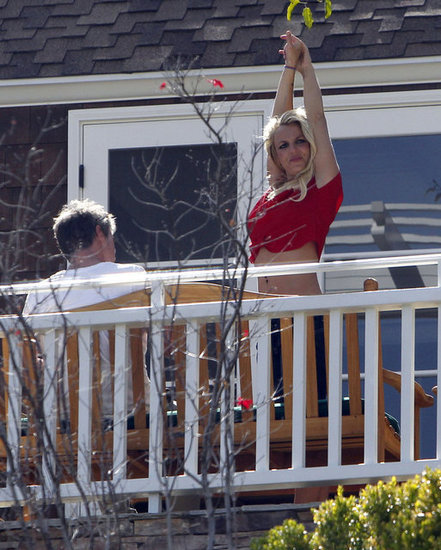 Britney Spears and Jason Trawick hung out on a balcony.