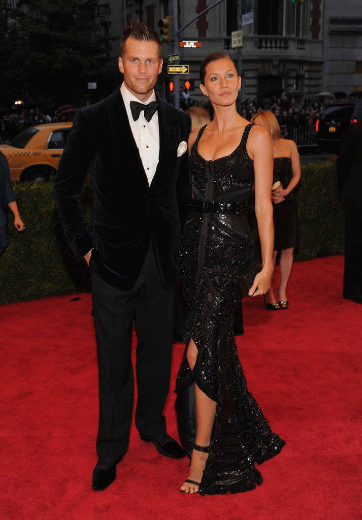 Gisele Bundchen and Tom Brady kept close on the red carpet of the Met Gala.