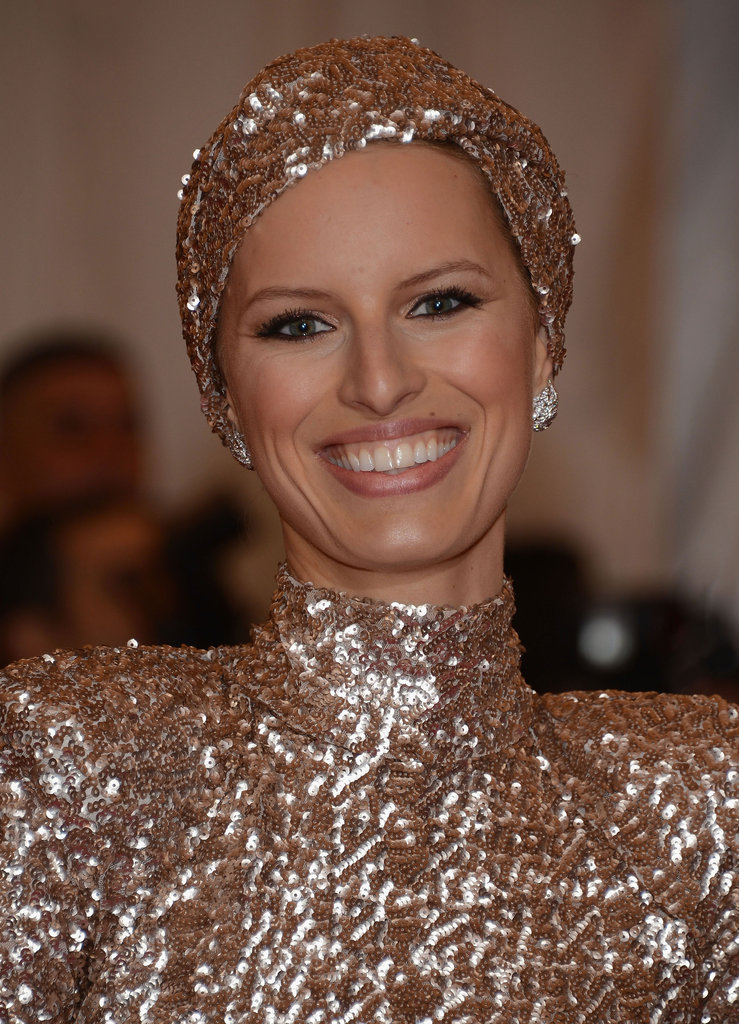 All smiles, Karolina glows in a glittering turban to match her gown.