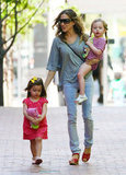 Sarah Jessica Parker took a stylish NYC stroll with her twin daughters, Tabitha and Loretta Broderick, in March 2012.