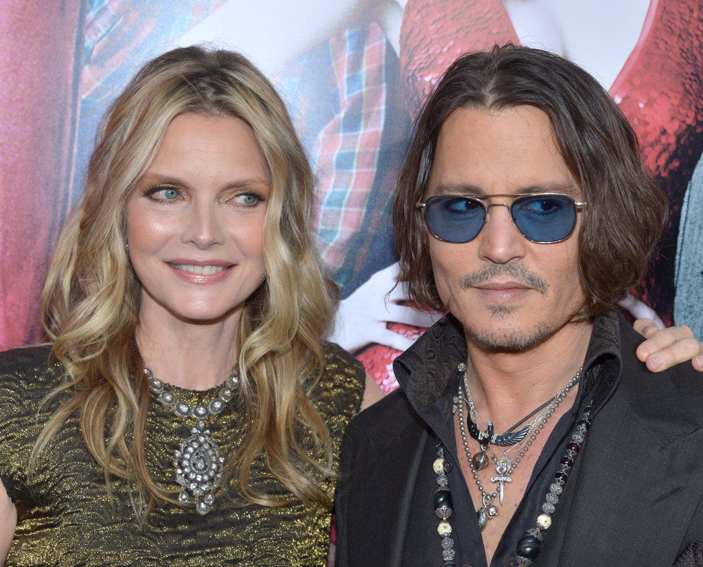 Michelle Pfeiffer had her arm around Johnny Depp for the Dark Shadows premiere in LA.