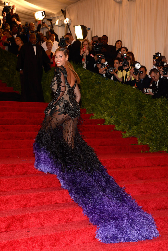 Beyoncé Knowles made a statement on the grand staircase with her flowing train of indigo feathers.