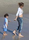 Jennifer Lopez bared her belly while showing love for son Max during a March 2012 beach day in LA.