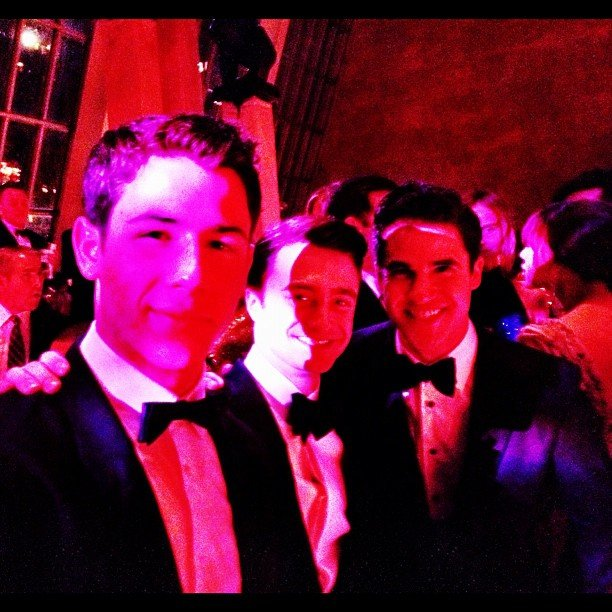 Inside the party Nick Jonas chatted with Darren Criss and Daniel Radcliffe. Source: Instagram User adamjosephj