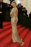 Cameron Diaz posed on the stairs of the Met Gala in a Stella McCartney gown.