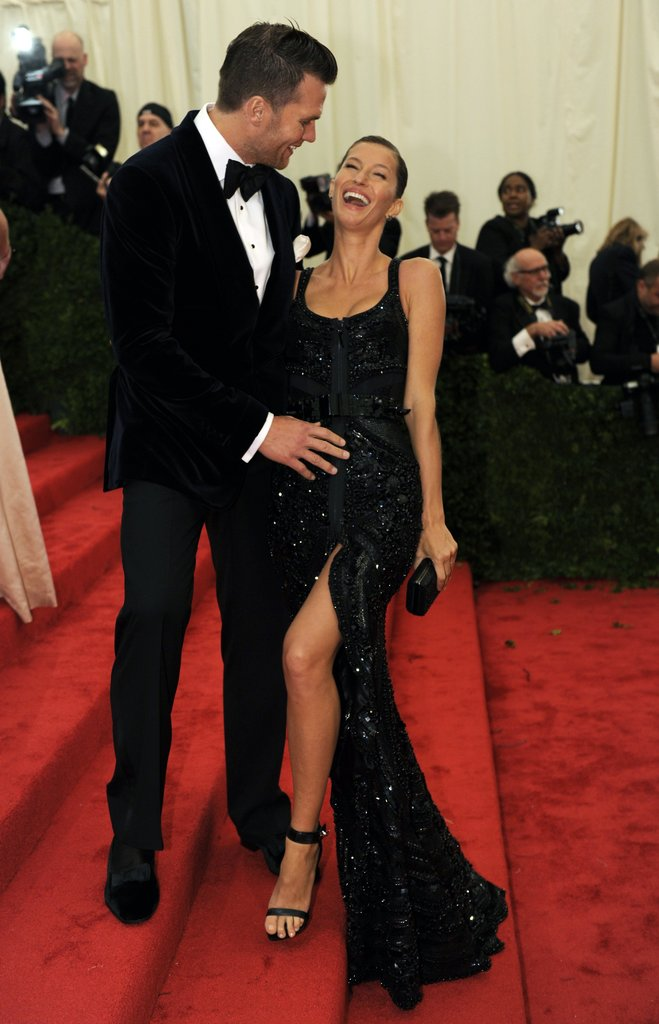 Gisele Bundchen laughed with husband Tom Brady on the red carpet stairs of the Met Gala.