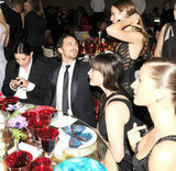 James Franco caught up with a pal while at a table with Liv Tyler and Gisele Bundchen. Billy Farrell/BFAnyc.com