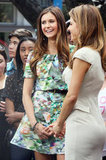 Nina Dobrev and Maria Menounos both smiled as they prepared for the interview.
