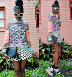 Prints on prints on prints that impress, not overwhelm. Pull off the same bold style with complementary mixed prints, a flash of color, and a pair of chic shades.  Photo courtesy of Lookbook.nu