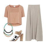 This look is perfect for Saturday shopping sprees or Sunday brunch with the girls — pair a cropped, boxy blush tee with a breezy high-waisted skirt in a neutral taupe tone, then add metallic heels and a woven statement necklace for a touch of tribal cool. Get the Look:  Reiss Archie Two Fabric Top ($170) Maison Martin Margiela Brushed Matte-Satin Maxi Skirt ($640) Sam Edelman Yelena Sandals ($100, originally $140) Orly Genger By Jaclyn Mayer Basking Necklace ($304)