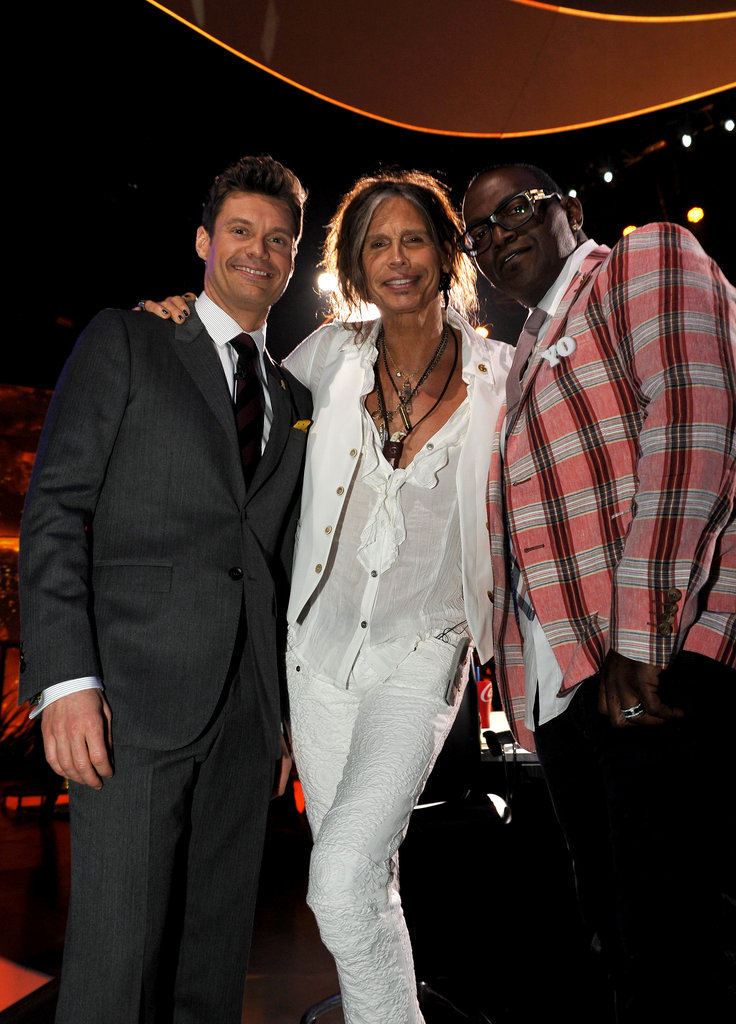 Ryan Seacrest posed for a photo with Randy Jackson and Steven Tyler.