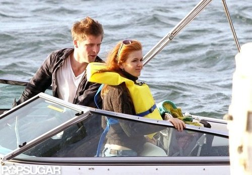 Isla Fisher wore a life jacket during a Sydney boat ride in October 2011.
