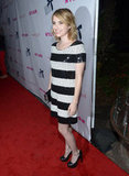 Emma Roberts paired black pumps with a black clutch for the event.