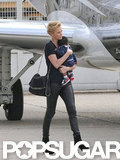 Charlize Theron wore her hair swept back for the flight.