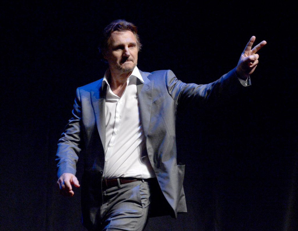 Liam Neeson gave the peace sign at the LA premiere of Battleship.