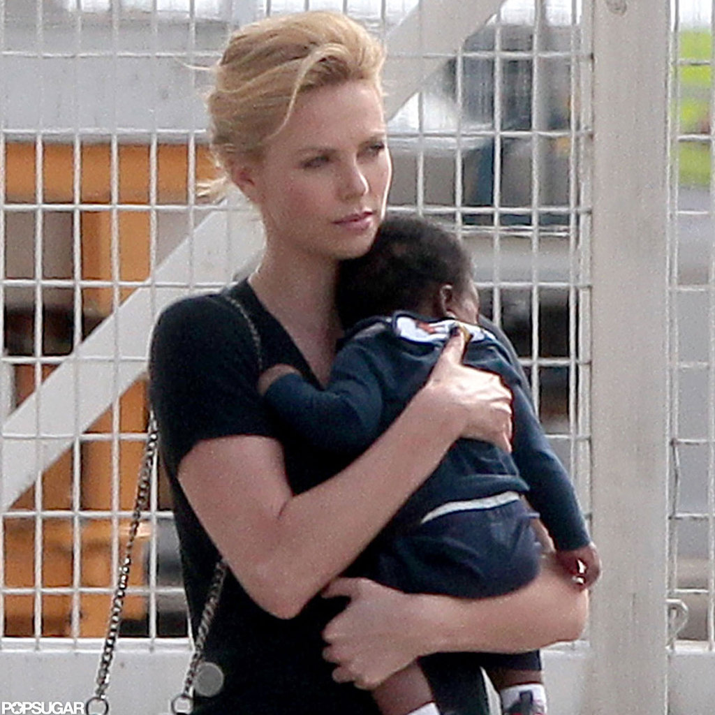 Charlize Theron held onto baby Jackson while boarding a private plane.