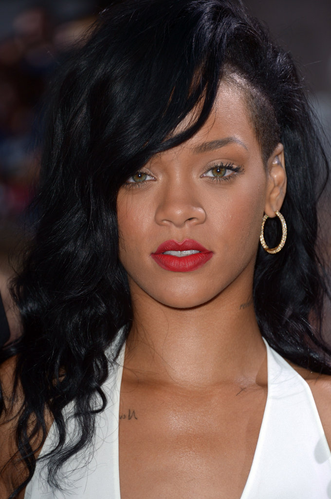Rihanna wore bright red lips with a white dress for the premiere of Battleship in LA.