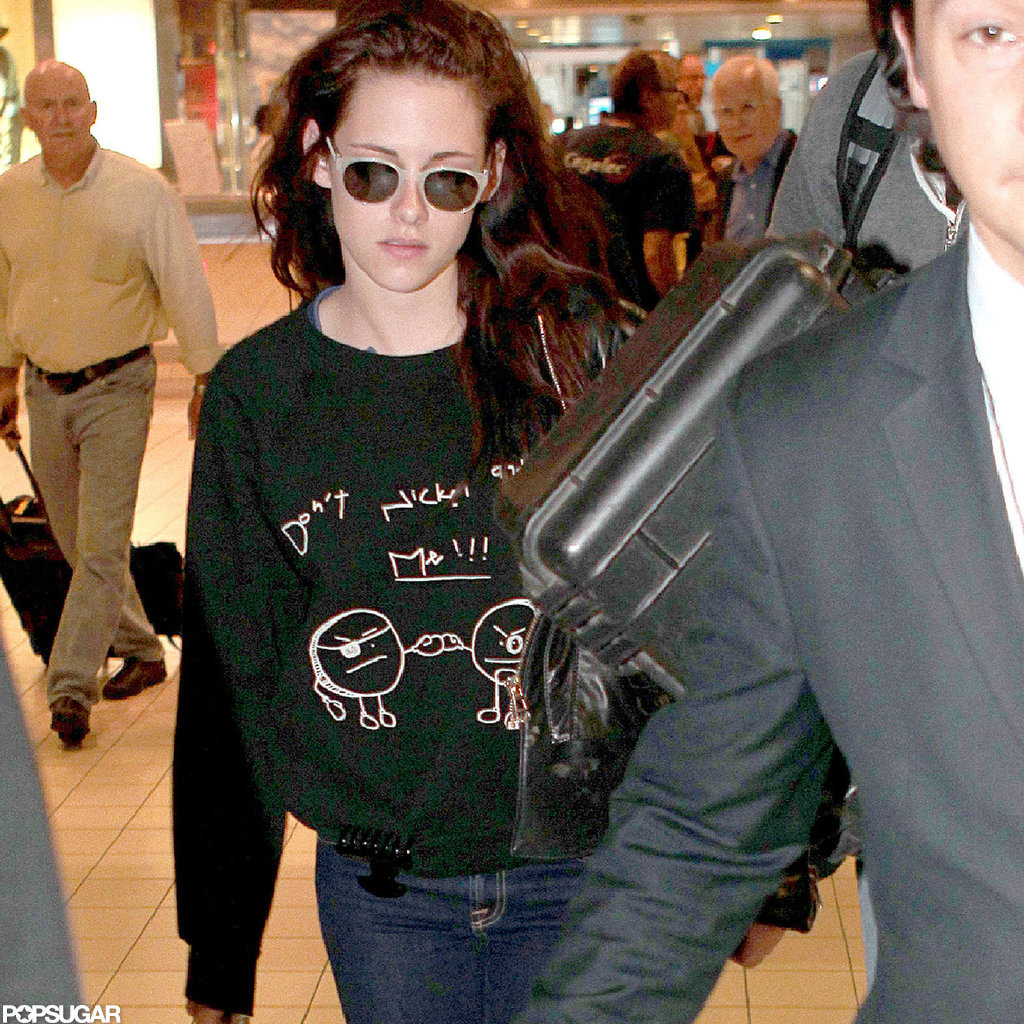 Kristen Stewart wore sunglasses after landing in Paris to embark on her European press tour for Snow White and the Huntsman.