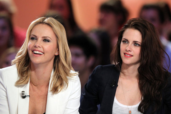 Kristen Stewart wore red lipstick with Charlize Theron.