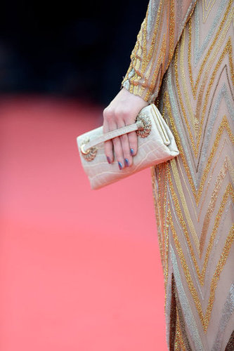Barbara Palvin finished off her look with a matching metallic clutch.