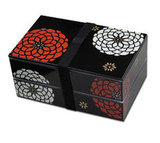 A red and white chrysanthemum motif brings this lacquered bento box ($30) to life.