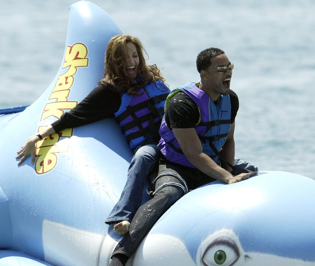 Will Smith and Angelina Jolie had fun on a raft for a stunt at a photocall for Shark Tale during the Cannes Film Festival in 2004.