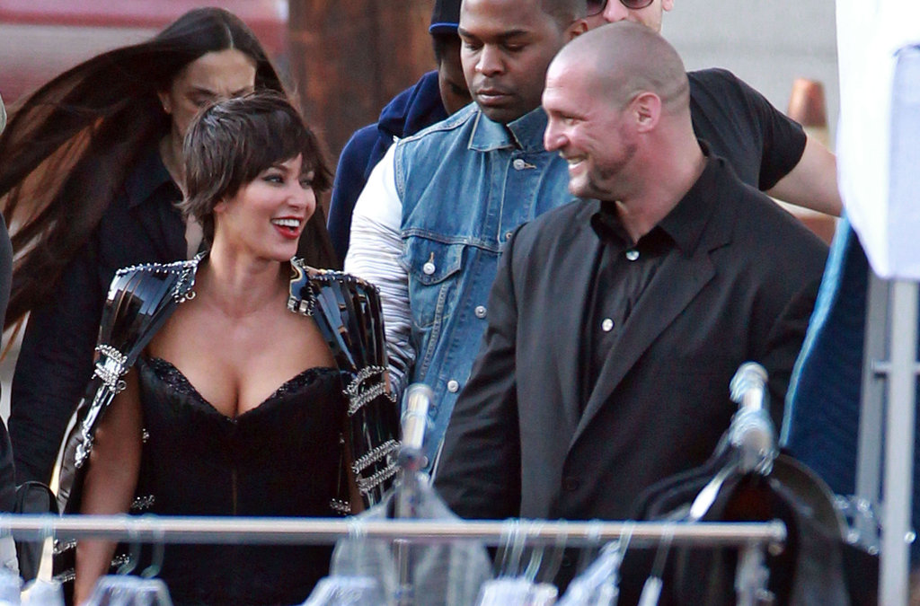 Kim Kardashian had a laugh while hanging out on the set of Vogue Italia's photo shoot.