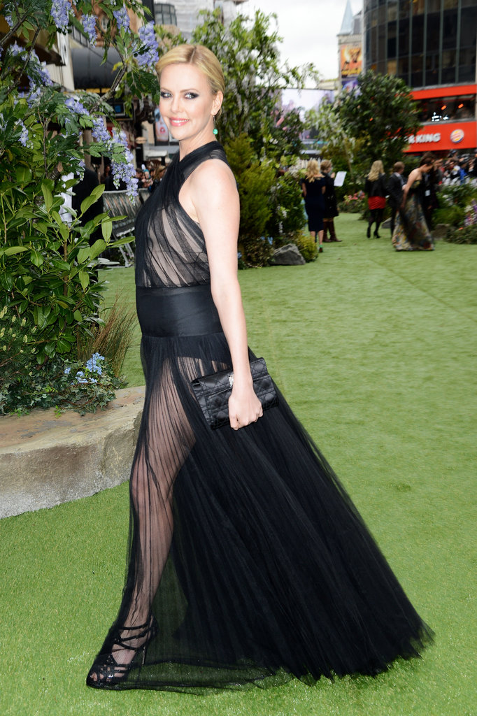 Charlize Theron posed in a see-through gown.