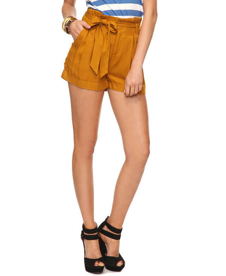 With slick Spring brogues, this feminine waist shorts get a daytime-cool feel, but switch out the flats for ankle-strap heels, and you've got yourself an evening-appropriate shorts look. Forever 21 Paper Bag Waist Shorts in Mustard ($14)