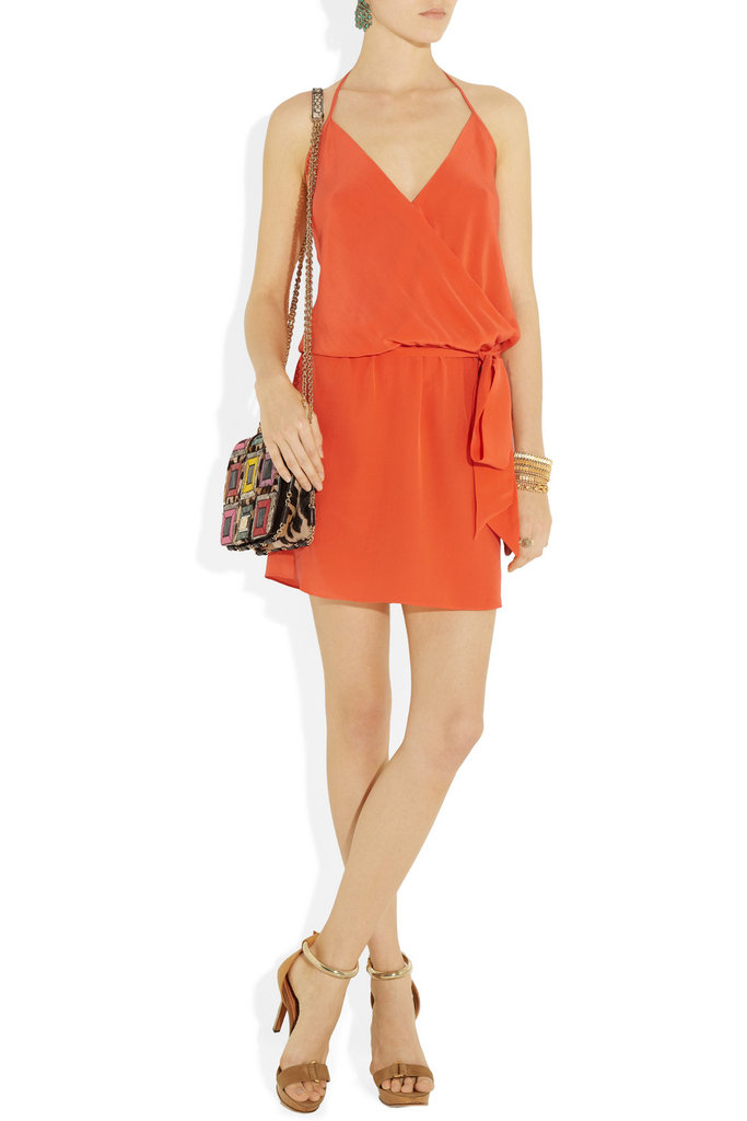 Between the silky halter-style silhouette and the bold orange hue, we couldn't think of a better Summer go-to and wedding dress must-have. Haute Hippie Silk-Georgette Wrap-Effect Dress ($375)