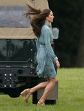 Kate kicked up her heels as she stepped onto the field, revealing her leg-elongating nude sandals.