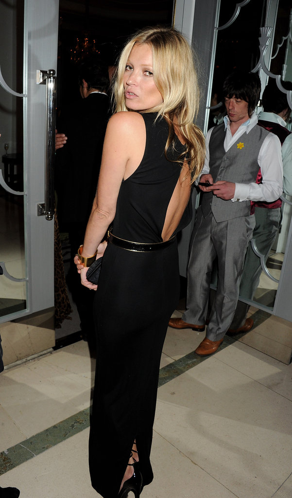 Kate Moss showed off her open back dress.