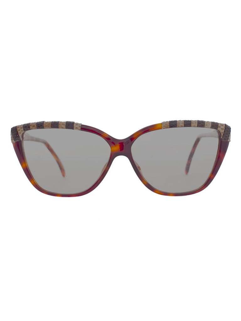 Not only do these sunglasses have the perfect Parisian-chic cat-eye shape, but the subtle stripes are pretty cool, too.  Vintage Emmanuelle Khanh Cat Eye Sunglasses ($100)