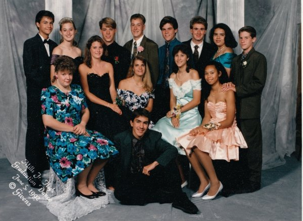 """Oh, the '90s! Floral prints and satin ruffles. You can't tell because of the girl in front of me, but my dress is covered in teal sequins [pictured back row, right]. I still own the dress and plan on wearing it when I turn 40. I'm pretty sure it's going to be back in by then."" — Sabrina Eldredge, senior product manager"