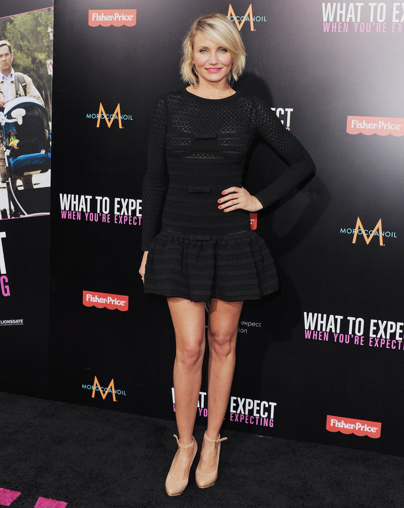 Cameron Diaz showed off her stems in an LBD with a flared skirt, long sleeves, and a belted waist. Ankle-strap nude pumps completed her ensemble.