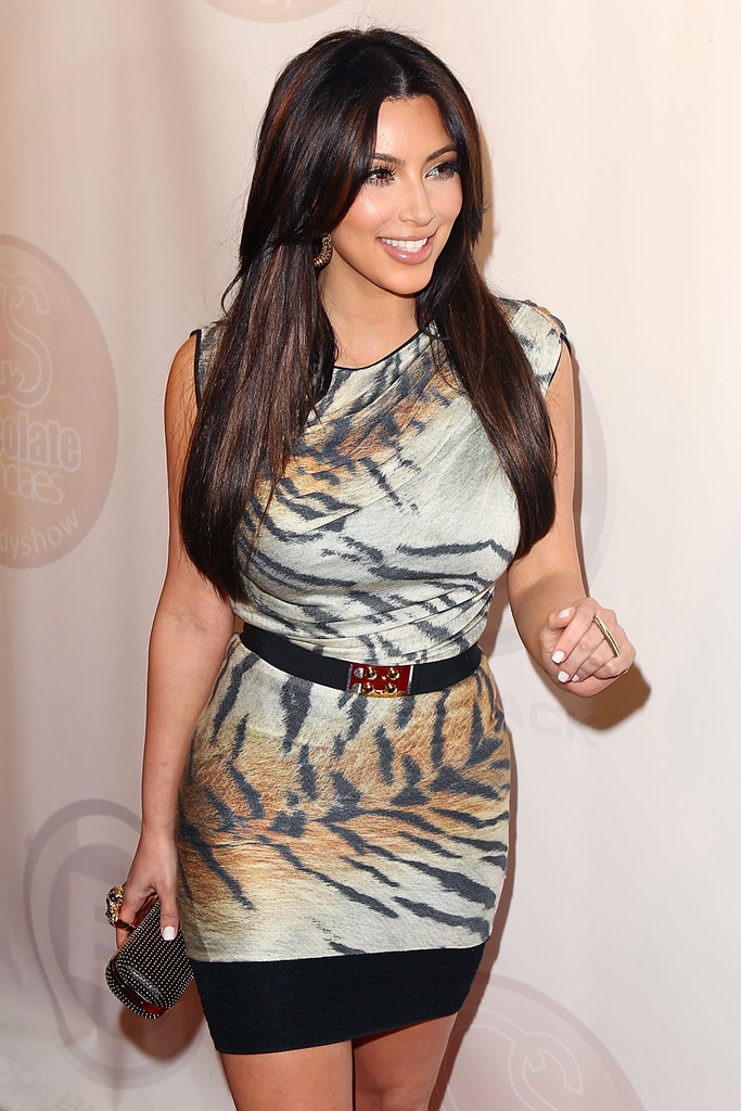 If you love yourself some flashy tiger print, like Kim does, then bid on this Giambattista Valli tiger print knit dress, currently at $205, to turn heads at your next dressy soiree. If you have a Miami or Vegas trip coming up, be sure to pack it with you.