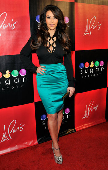 Kim wore this teal Gucci pencil skirt, currently at $285, in Las Vegas in March 2011, but it's classic enough to wear in any city and any year. It would also look smashing with a colorful floral blouse, like this one from Free People ($198), for a more springy feel.