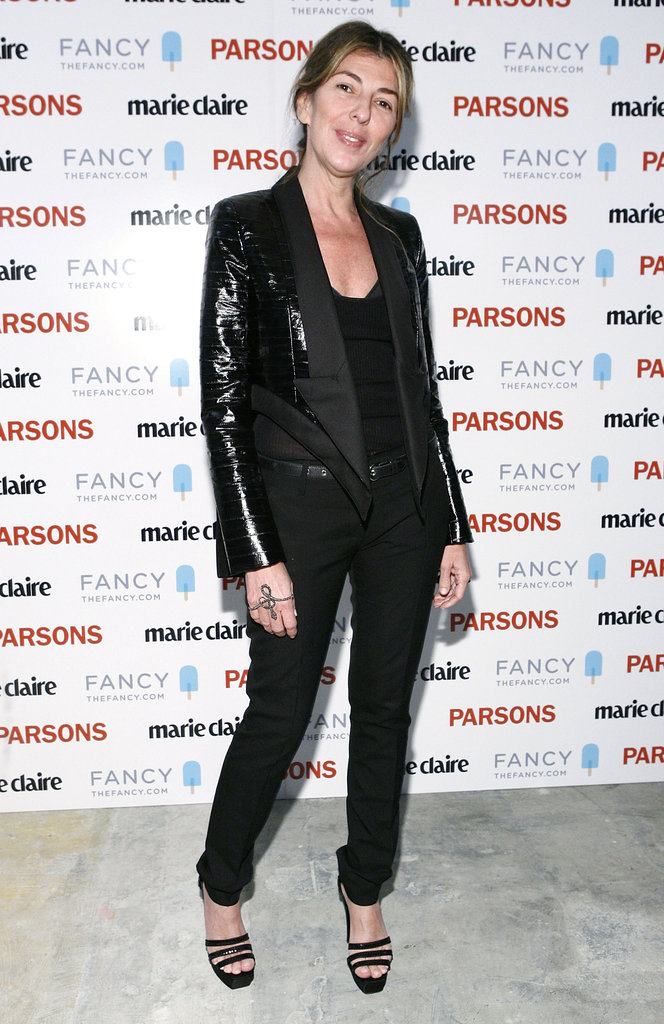 Nina Garcia worked a menswear-chic all-black look with a shiny blazer, black trousers, and stunning black platform sandals at an event in NYC.