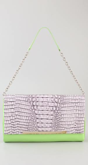 Purple crocodile-embossed texture? Need we say more? Diane von Furstenberg Adele Embossed Crocodile Clutch ($395)
