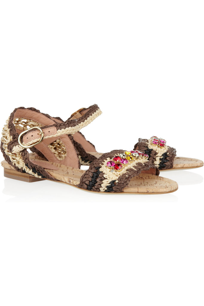 We love the natural woven textures combined with the jeweled embellishments — these are an investment, but the kind you'll keep for seasons.  Dolce & Gabbana Crystal-Embellished Raffia Sandals ($975)