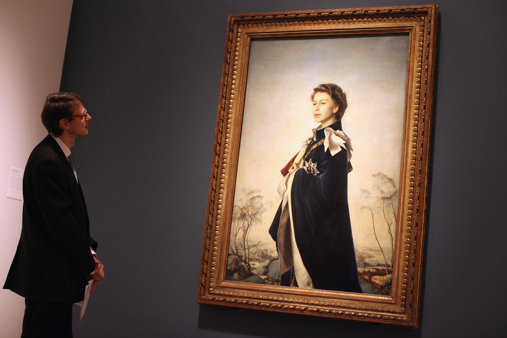 "A man took in Pietro Annigoni's ""Queen Elizabeth II, Queen Regent."""