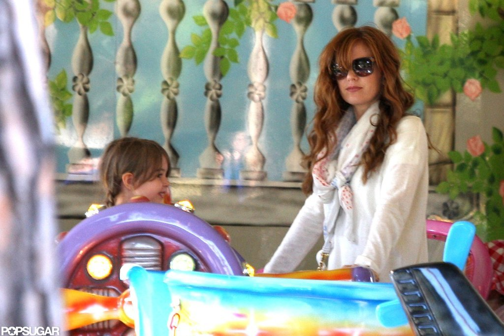 Isla Fisher played outside with her daughters.