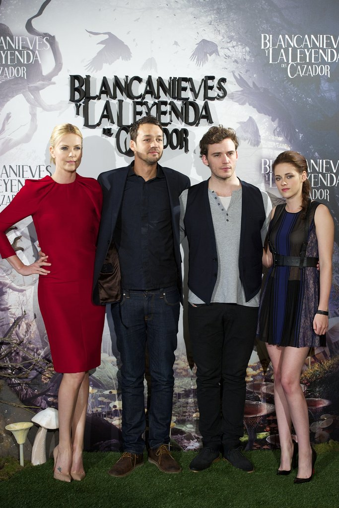 Charlize Theron, Rupert Sanders, Sam Claflin, and Kristen Stewart posed together for the Snow White and the Huntsman photocall in Madrid.