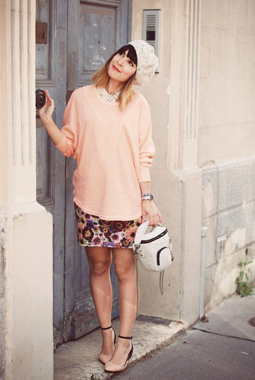 Pair an oversized solid-hued sweater with a sweet floral skirt and ankle-strap flats for a sunny feel. Photo courtesy of Lookbook.nu